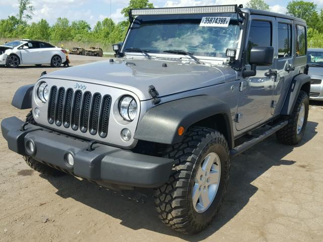 1C4BJWDG8FL730293 - 2015 JEEP WRANGLER U GRAY photo 2