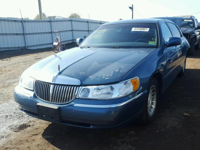 1lnhm81w41y735782 2001 Lincoln Town Car E Blue Price History